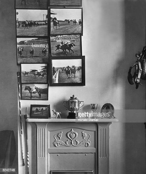 Racing pictures and riding whips on the wall of sixteen year old jockey Lester Piggott's bedroom