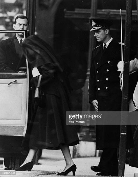 Her Majesty the Queen and the Duke of Edinburgh entering their car after the funeral of Queen Mary