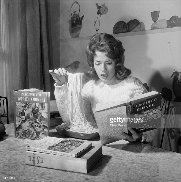In her flat in London's Montague Square actress Diane Aubrey tucks into a giant serving of pasta while reading a cookbook entitled 'Spaghetti Dinner'