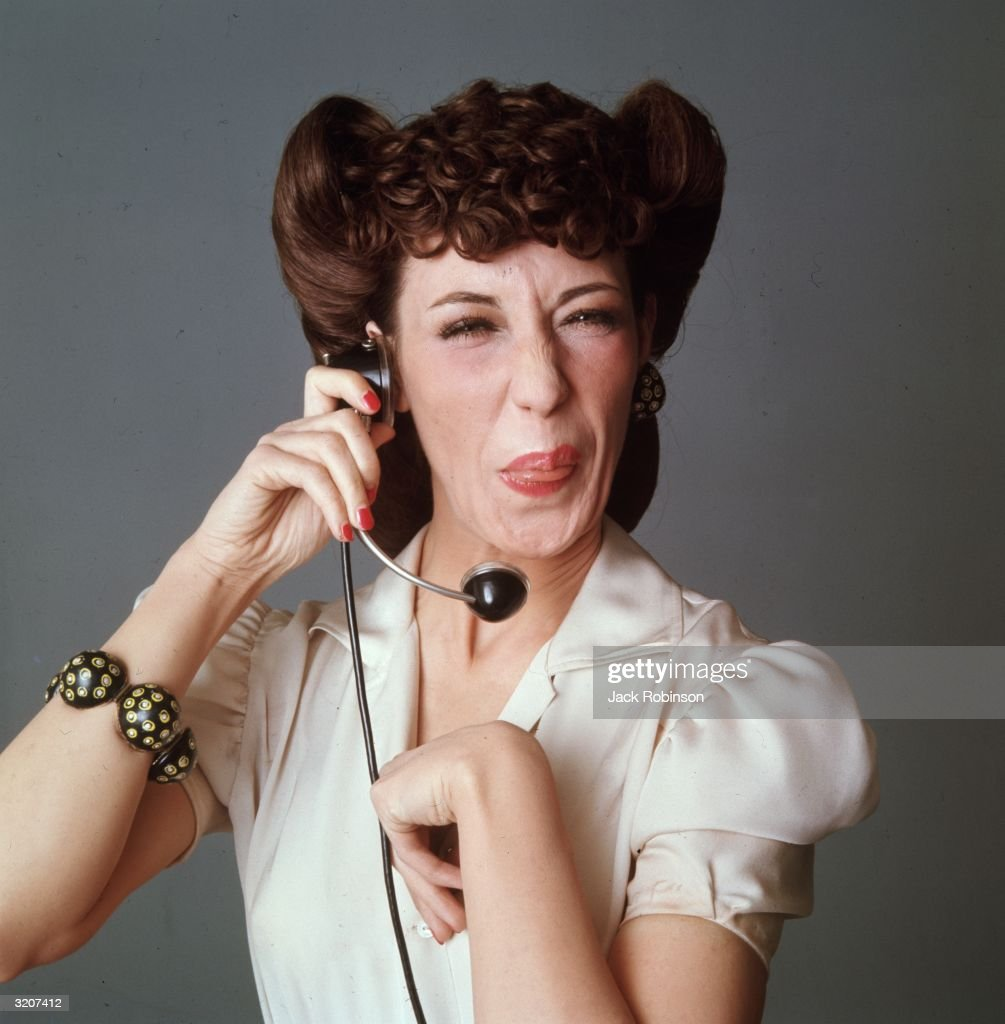 Studio portrait of American comedian and actor Lily Tomlin in costume as a switchboard operator from the television series 'LaughIn'