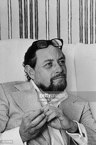 Portrait of American playwright Tennessee Williams seated during an interview at the Hotel Elysee in New York City
