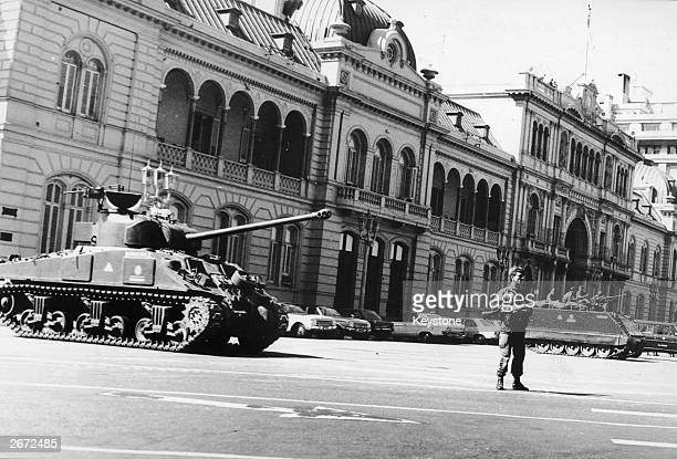 Argentinian soldiers stand guard outside Government House after the coup which deposed President Isabel Martinez de Peron widow of the late President...
