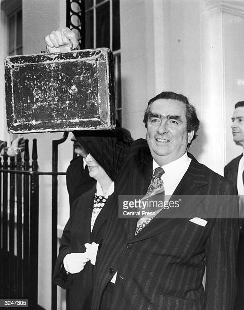 Denis Healey British Chancellor of the Exchequer holds up his budget box for all to see as he leaves Number 11 Downing Street London for the House of...
