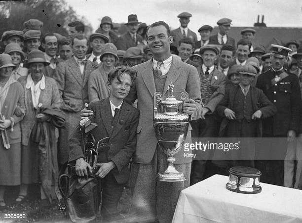 American golfer Jesse Sweetser with his caddy and the cup after winning the Amateur Golf Championship at Muirfield golf course in Gullane East...