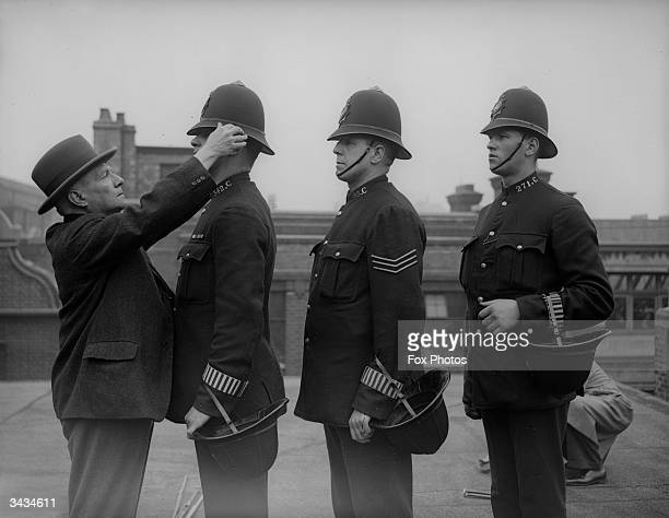 British policemen are issued with new helmets