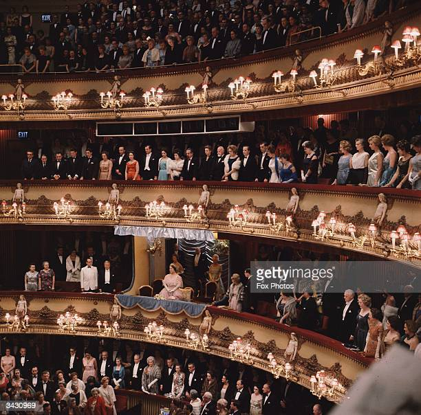 The crowd rises for the Queen Mother as she attends a Royal Gala Performance of Mozart's 'The Marriage of Figaro' at the Covent Garden Opera House...
