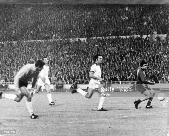 George Best about to score Manchester United's second goal during the European Cup Final match against Benfica at Wembley United went on to win 41...