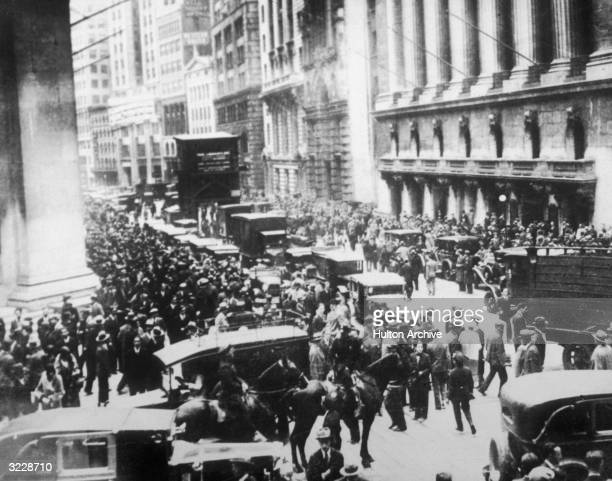 Workers flood the streets in a panic following the Black Tuesday stock market crash on Wall Street New York City