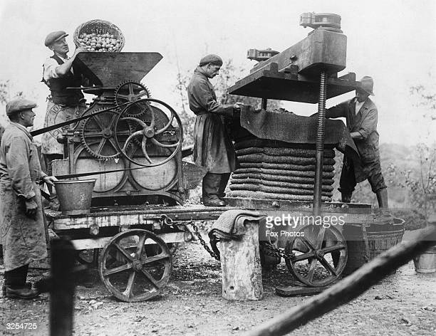 Farmers using a portable cider maker in Somerset