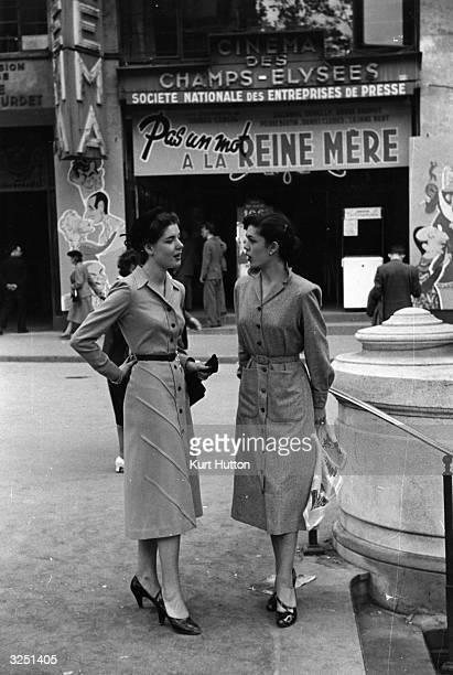 Two Parisian women on the Champs Elysees wearing Britishmade dresses available from Paris boutique Au Printemps Original Publication Picture Post...
