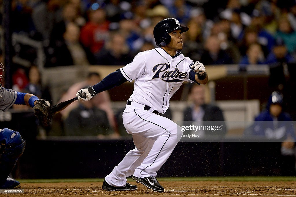 Alexi Amarista of the San Diego Padres hits during the game against the Los Angeles Dodgers at Petco Park on April 2 2014 in San Diego California