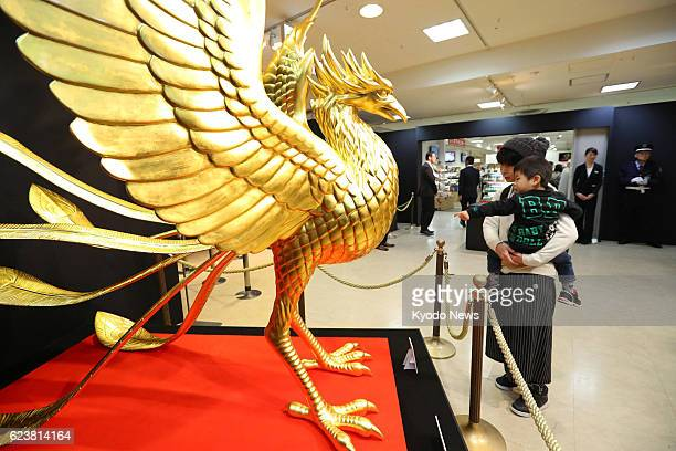 A 2metertall statue of a Chinese phoenix gilded with some 5000 gold leaf sheets is displayed on Nov 17 at Takashimaya Co department store in the...