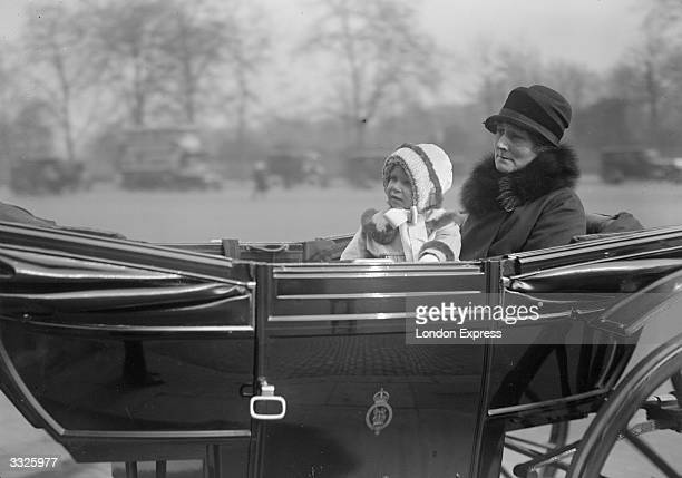 Baby Princess Elizabeth with her nurse goes for a drive in the park in an open carriage