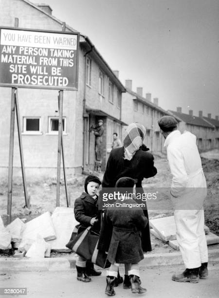 A mother and her toddlers chat with a workman on one of two housing estates at Kirkby in Liverpool 30 or 40 houses are built there every week in an...