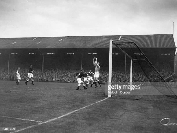 The goalkeeper saves during a Hearts versus Hibernian football match Hearts' official name Heart of Midlothian comes from a dance hall on Canongate...