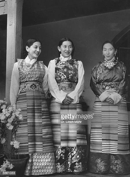 Three women from Sikkim the northern Indian state which borders with Tibet wearing traditional clothing