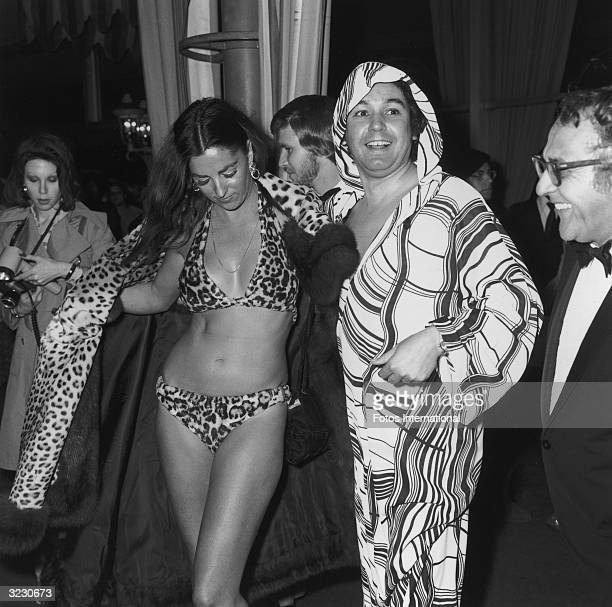 American actor Edy Williams opens her leopard fur coat to reveal a leopard fur bikini at the Academy Awards Dorothy Chandler Pavilion L A County...