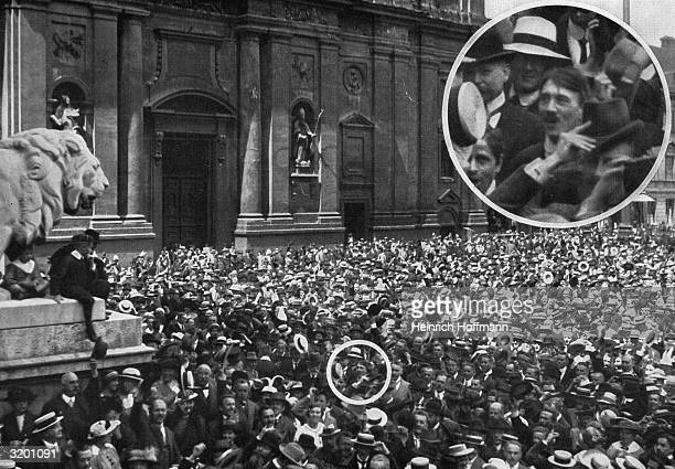 Highangle view of a crowd gathered in the Odeon Platz in Munich Germany An inset shows future Nazi leader Adolf Hitler in the crowd
