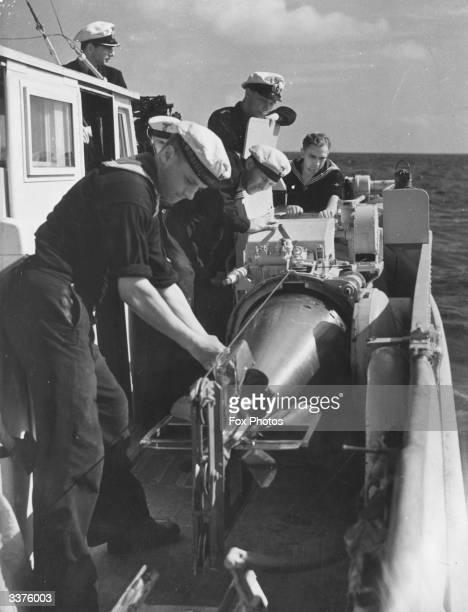 Sailors hauling a torpedo aboard a German torpedo motor boat during World War II