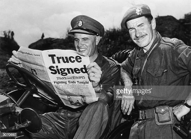 Brigadier Jean Allard Commanding Officer of the Canadian Brigade breaks the news of a truce in the Korean war to Colonel K L Campbell Commander of...