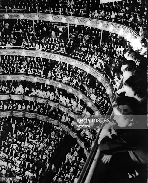 An audience inside the old Metropolitan Opera House New York