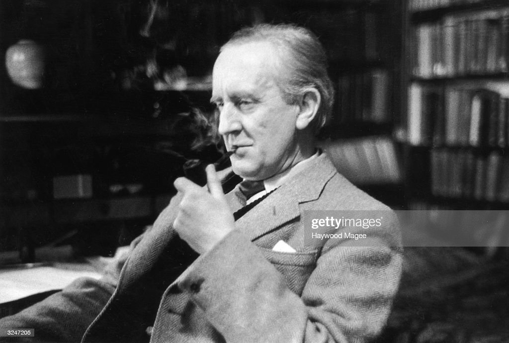 British writer J R R Tolkien (1892 - 1973), enjoying a pipe in his study at Merton College, Oxford, where he is a Fellow. Original Publication: Picture Post - 8464 - Professor J R R Tolkien - unpub.