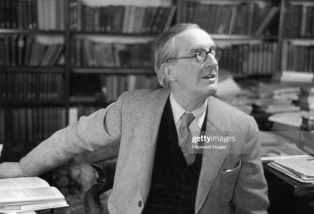 British writer John Ronald Reul Tolkien (1892 - 1973), sitting in his study at Merton College, Oxford, where he is a Fellow. Original Publication: Picture Post - 8464 - Professor J R R Tolkien - unpub.
