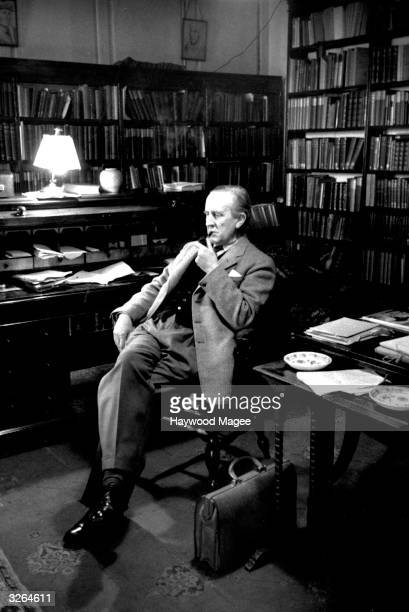 British writer John Ronald Reul Tolkien sitting in his study at Merton College Oxford where he is a Fellow Original Publication Picture Post 8464...