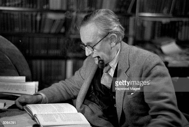 John Ronald Reuel Tolkien British writer and professor at Merton College Oxford reading in his study Original Publication Picture Post 8464 Professor...