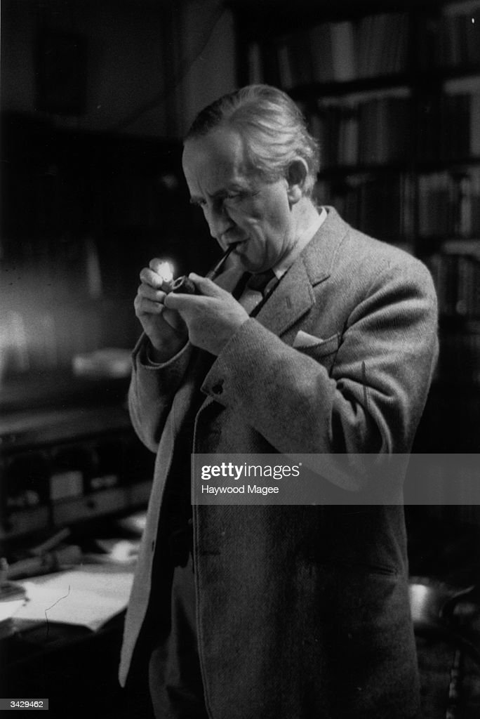 Taking a relaxing smoke, Fellow of Merton College, Oxford, Professor J R R Tolkien (John Ronald Reuel Tolkien) (1892 - 1973) . Philologist and author of 'The Hobbit' and its sequel 'The Lord of the Rings'. Original Publication: Picture Post - 8464 - Professor J R R Tolkien - unpub.