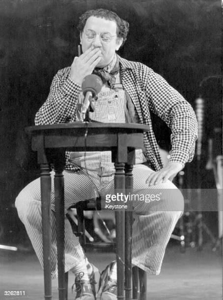 French comedian Coluche performing in Paris