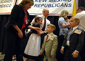 2nd District candidate Greg Sowards embraces his rand daughter Cindy while leaving the stage with his family after speaking at the state republican...