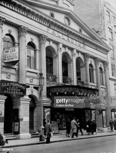 One of London's most famous theatres the London Palladium with a sign advertising 'London Rhapsody' a show starring the Crazy Gang