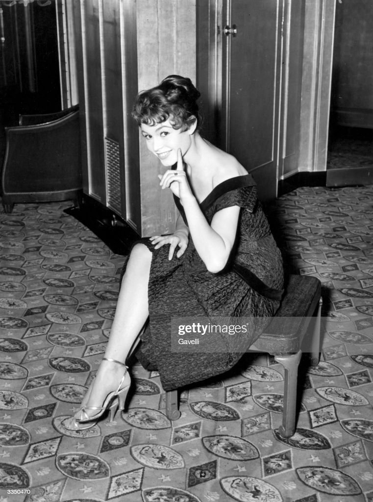 French actress, <a gi-track='captionPersonalityLinkClicked' href=/galleries/search?phrase=Brigitte+Bardot&family=editorial&specificpeople=202903 ng-click='$event.stopPropagation()'>Brigitte Bardot</a> sitting on a stool in a London hotel with her hair dyed a dark shade.