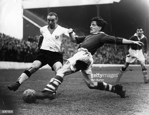 Stanley Matthews of Blackpool and Billy Kiernan of Charlton Athletic battle for the ball during a match at The Valley