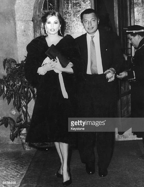 Fiat tycoon Gianni Agnelli leaves the Hostaria dell'Orso in Rome with Swedish film star Anita Ekberg in the early hours of the morning