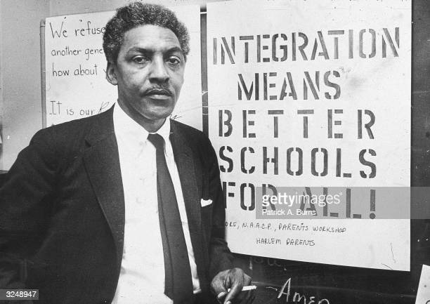 American civil rights activist Bayard Rustin spokesman for the Citywide Committee for Integration at the organization's headquarters at Silcam...