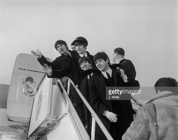 The Beatles left to right George Harrison John Lennon Ringo Starr and Paul McCartney at London Airport on their way to appear in New York