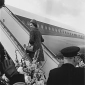 Queen Elizabeth II boards the plane at Heathrow airport for her tour of New Zealand and Australia a two month visit which coincides with the Captain...