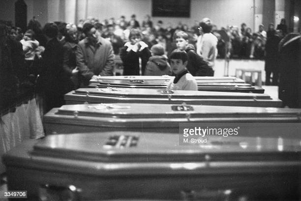 Coffins of the 13 civilians shot dead by British Paratroopers on Bloody Sunday lined up for the funeral at St Mary's church in Derry City