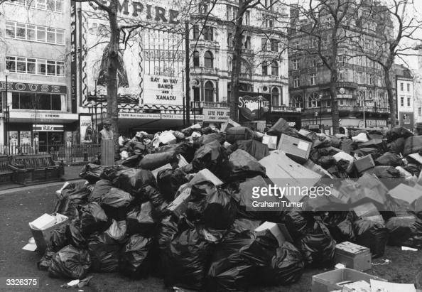 A huge pile of rubbish accumulates in Leicester Square London the official dumping ground during a refuse collection strike