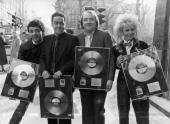 Rowan Atkinson Griff Rhys Jones Mel Smith and Pamela Stephenson from the television show 'Not the Nine O'Clock News' in Baker Street London with gold...