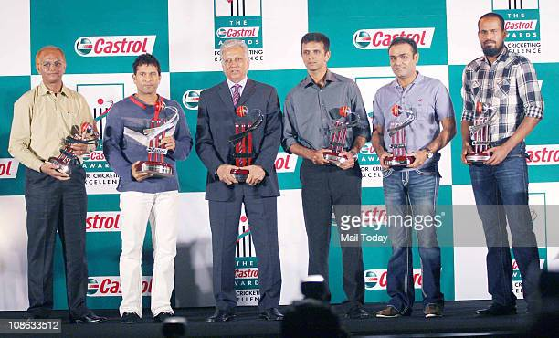 2nd from left Indian cricketer Sachin Tendulkar former cricketer Mohinder Amarnath Rahul Dravid Virender Sehwag and Yusuf Pathan hold their...