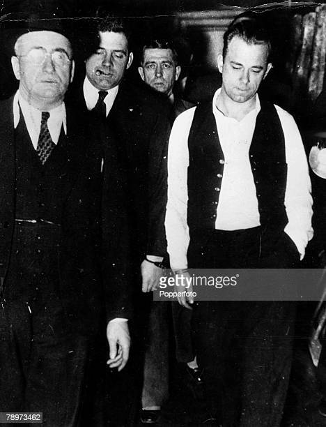 2nd January 1934 John Dillinger is pictured being taken to the Showup in the county jail in Crown point Indiana where he was viewed and identified by...