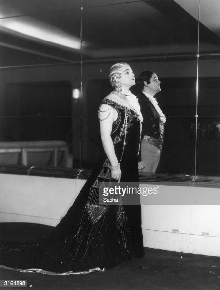An actor dressed half as a man and half as a woman reflects his more masculine side in a studio mirror He is part of the 'New York 1936' show at...