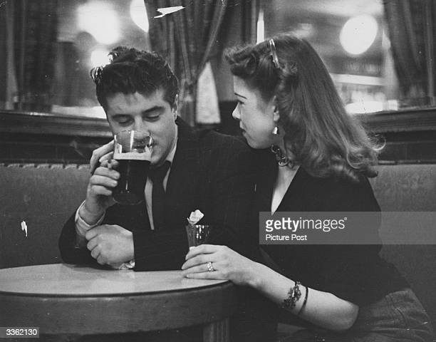A young man having a drink in a London pub with his girlfriend Original Publication Picture Post 6851 The Best And Worst Of Britain 5 The Young...