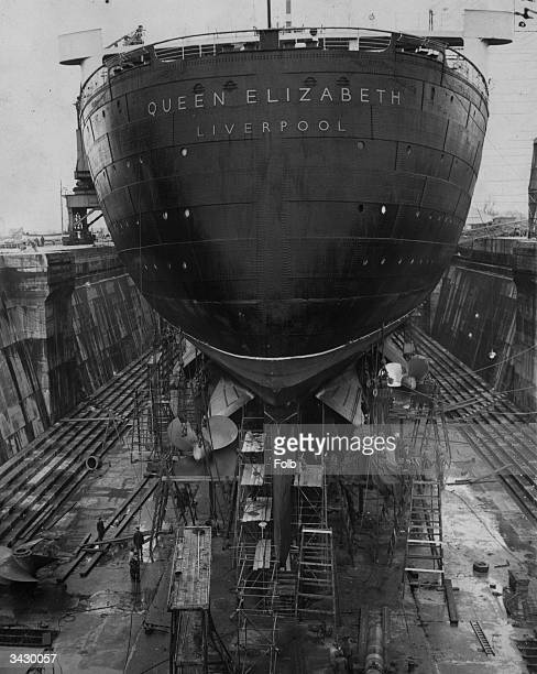 The massive hull of the Cunard liner Queen Elizabeth as she undergoes her annual overhaul at the King George V Dock Southampton