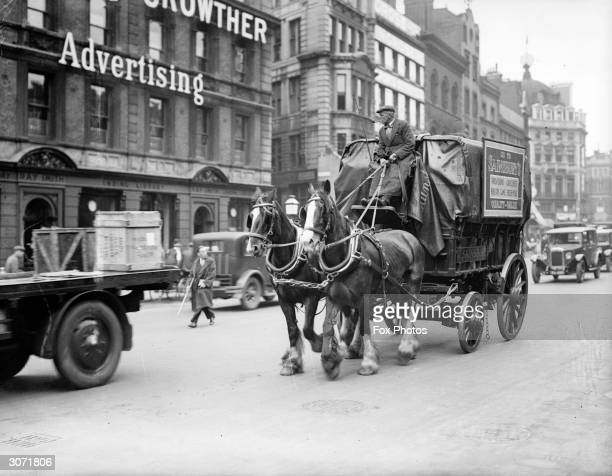 A horse and cart carrying wares for delivery to Sainsbury's a British supermarket chain
