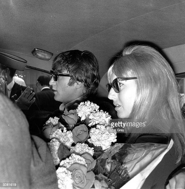 Beatle John Lennon and his wife Cynthia leaving London Airport in a car having returned from the Beatles' Australian tour