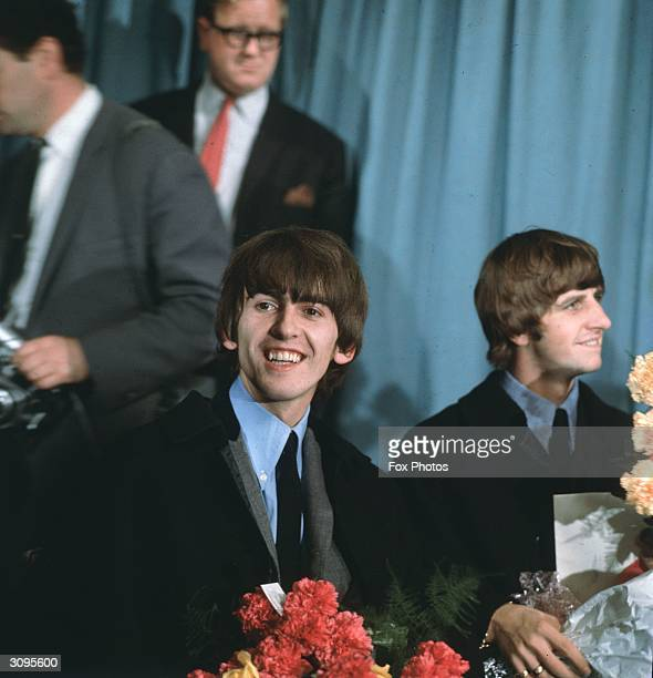 George Harrison and Ringo Starr of the Liverpudlian pop group The Beatles at a press conference in London Airport following a tour of Australia